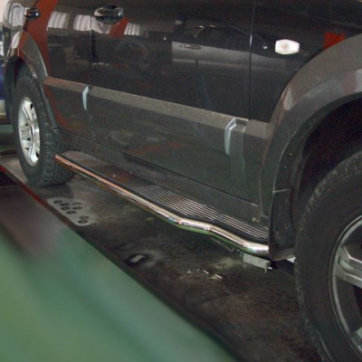 Estribos en plataforma tubo inox Kia Sorento 2002-2009